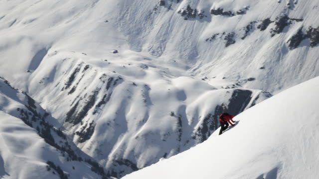 climber climbs on a snow-covered mountain - aspirations stock videos & royalty-free footage