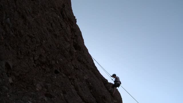 climber descending cliff using rope - argentinian ethnicity stock videos & royalty-free footage