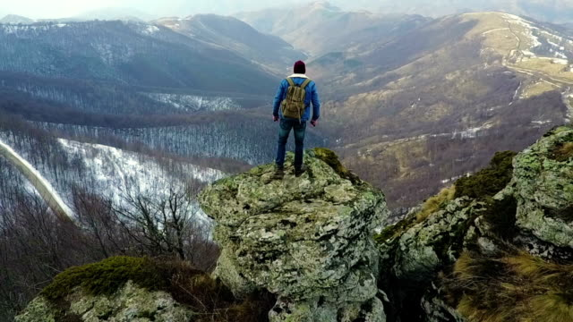 climber enjoys the view from the top of the mountain - mountain peak stock videos and b-roll footage