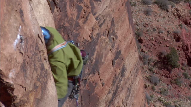 ms zi pan climber falls of rock face and rope catches climber and climber screams  / zion, ut, usa - rock face stock videos & royalty-free footage