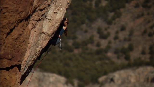 ms ts tu climber makes very difficult moves up steep rock face / canon city / shelf road,co,usa   - rock face stock videos & royalty-free footage