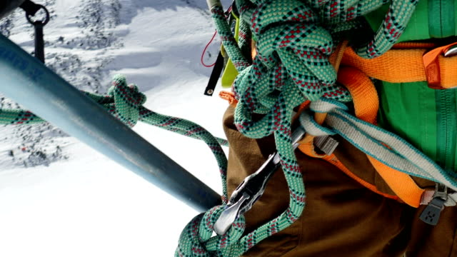climber on a mountain side. caucasus mountains. equipment details - climbing equipment stock videos and b-roll footage