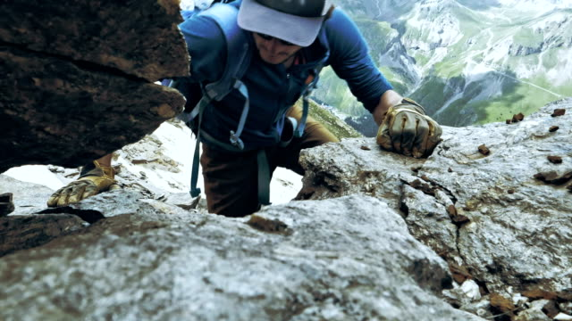 climber on a rock wall. caucasus mountains - stone material stock videos & royalty-free footage