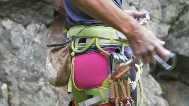climber on the italian alps - preparation detail - krab stock videos & royalty-free footage