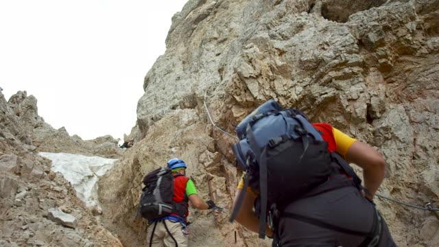Climber on the via ferrata