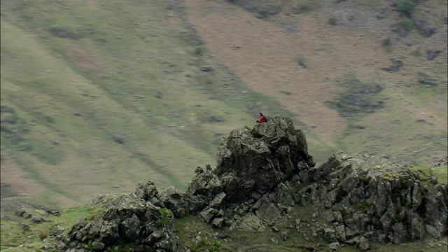 Climber On Top Of Langdale Pikes  - Aerial View - England, Cumbria, South Lakeland District, United Kingdom