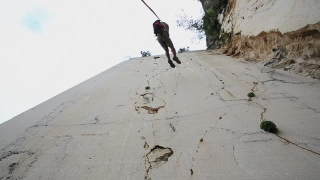 climber rappels (abseils) over marble slabs, at quarry - abseiling stock videos & royalty-free footage