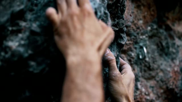 climber trying to climb up the rock - free climbing stock videos & royalty-free footage