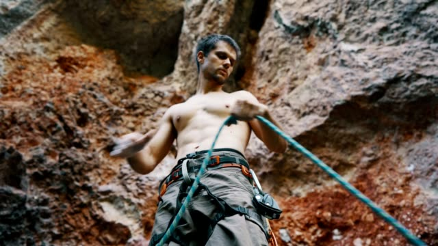 climber unwinding a rope - krab stock videos & royalty-free footage