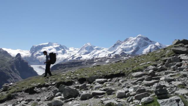 Climber walking in European Alps.