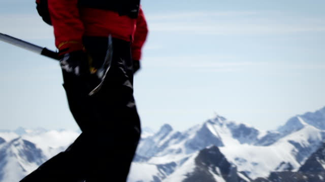 climber walks over snow on a mountain - mountain climbing gear stock videos and b-roll footage