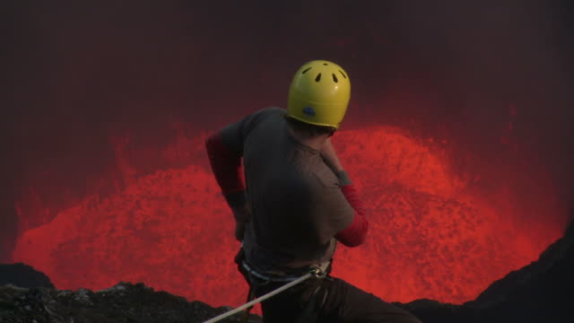 climber watches lava erupting from volcano, marum volcano, ambrym island, vanuatu - geologist stock videos & royalty-free footage