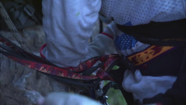 climbers adjust their ropes and harnesses. - safety harness stock videos & royalty-free footage