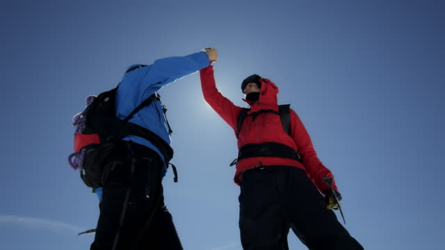 Climbers are cheering on a mountain peak