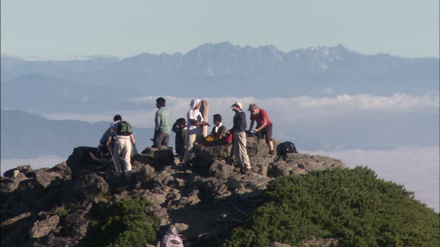 climbers enjoy the view from mt. shiomidake in the southern alps of japan. - tourism stock videos & royalty-free footage