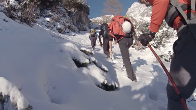 climbers hike towards the top of a mountain. - hiking stock videos & royalty-free footage