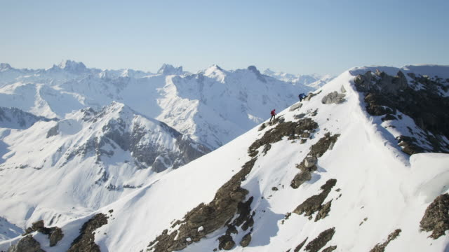 climbers on a snow-covered mountain - mountain range stock videos & royalty-free footage