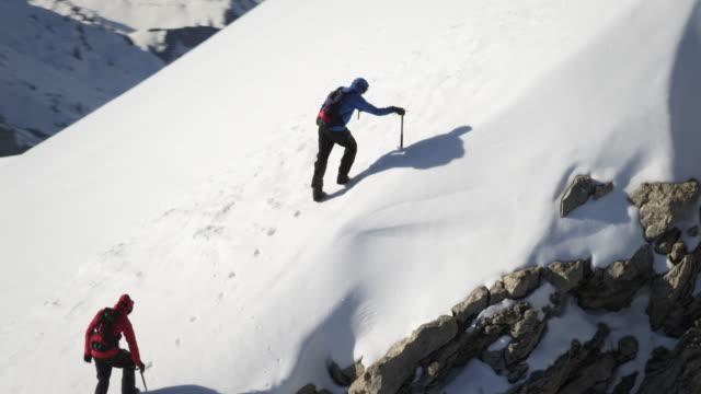 climbers on a snow-covered mountain - hiking stock videos & royalty-free footage