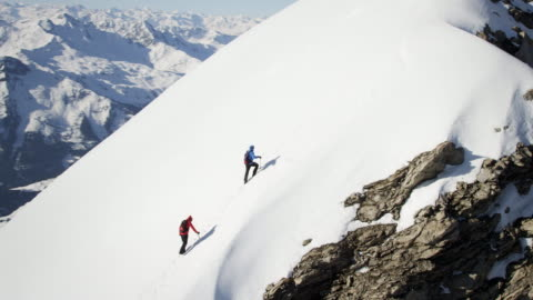 climbers on a snow-covered mountain - mountain peak stock videos & royalty-free footage