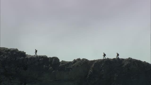 aerial climbers on mountain ridge, tyrol, austria - clambering stock videos & royalty-free footage