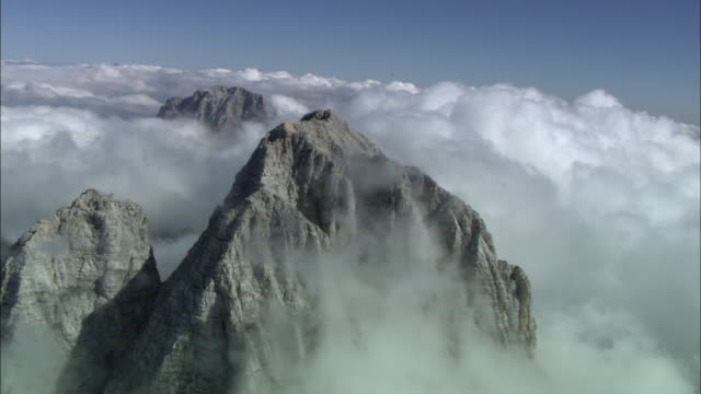 AERIAL Climbers on mountain summit, Tyrol, Austria