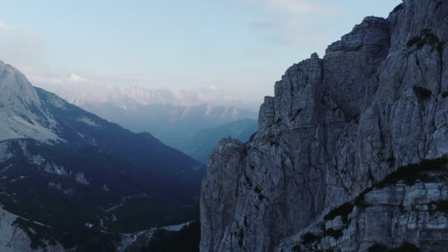 climbers on top of a mountain from aerial view - slovenia stock videos & royalty-free footage