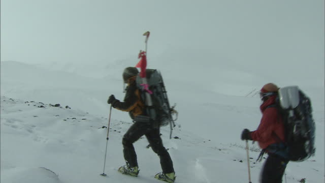 climbers_daisetsuzan volcanic group in winter, hokkaid_ - daisetsuzan volcanic group stock videos and b-roll footage