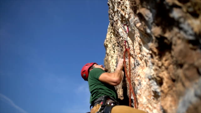 climbing a rock - safety harness stock videos & royalty-free footage