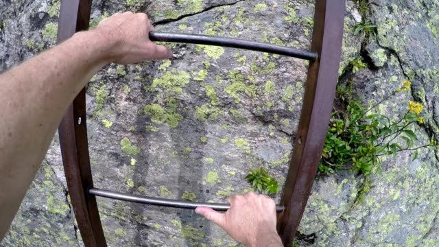 climbing a steel ladder mountain climbing hiking in the french alps on the tour du mont blanc - auvergne rhône alpes stock videos & royalty-free footage