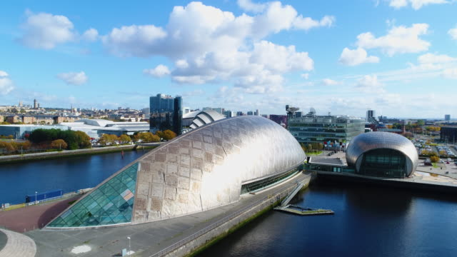 climbing aerial shot of the glasgow science centre and glasgow cityscape - museum stock videos & royalty-free footage