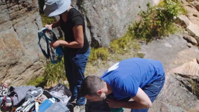 Climbing couple: walking and preparing equipment together