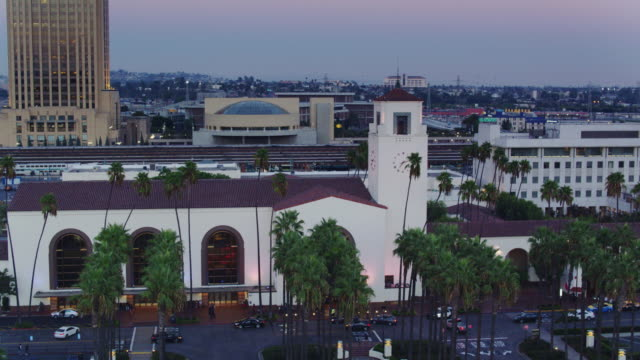 climbing drone shot of union station, los angeles at dusk - union station los angeles stock videos & royalty-free footage