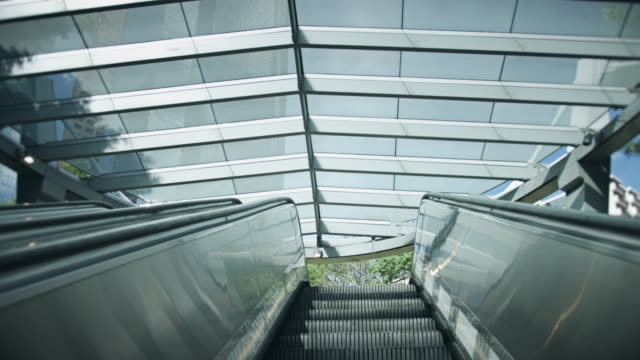 climbing escalator - escalator stock videos & royalty-free footage