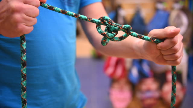 climbing knot tying - rope stock videos & royalty-free footage
