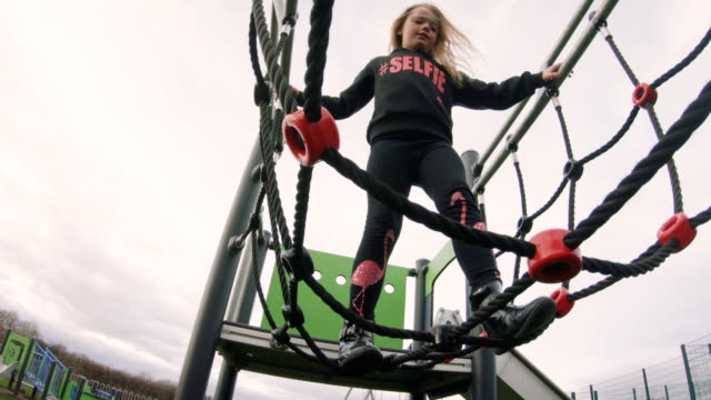 climbing on a jungle gym - climbing frame stock videos & royalty-free footage