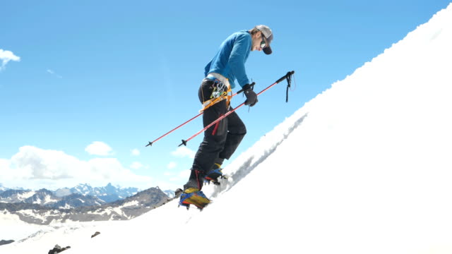 climbing on a snowy slope. caucasus mountains - climbing equipment stock videos and b-roll footage