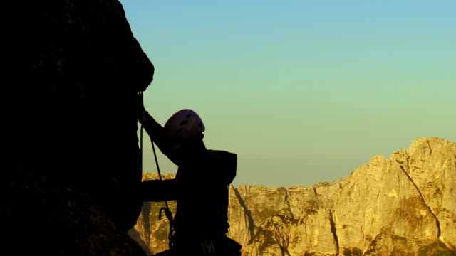 hd: climbing on a steep cliff - free climbing stock videos & royalty-free footage
