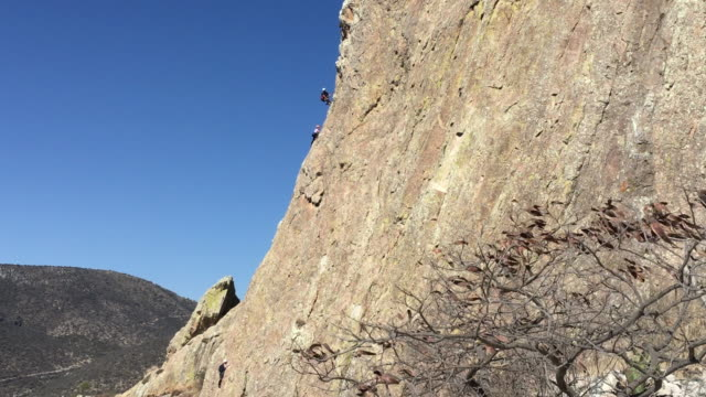 climbing peña bernal monolith - distant stock videos and b-roll footage