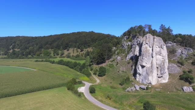 climbing rock in jurassic mountain range - jurassic stock videos & royalty-free footage