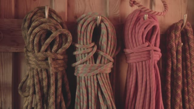 climbing ropes in morning light - climbing equipment stock videos and b-roll footage