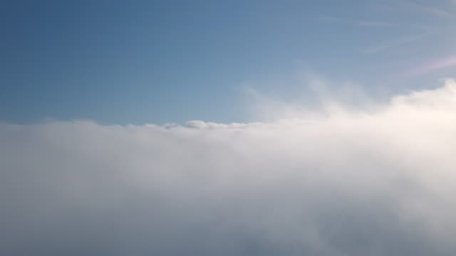 Climbing through the clouds above England as seen from the Pilot's point of view