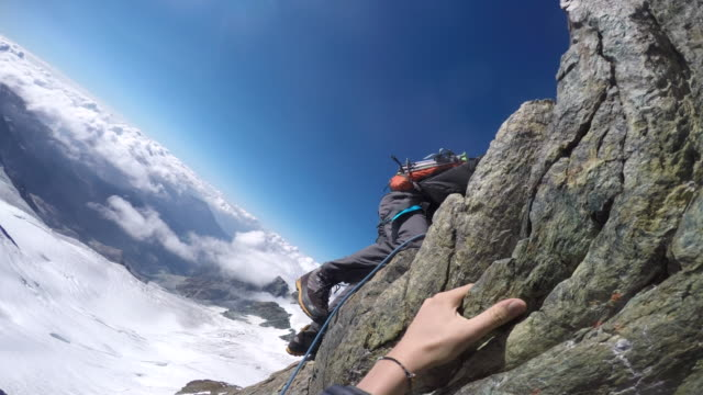 pov climbing up steep alpine ridge and cliff - climbing stock videos & royalty-free footage