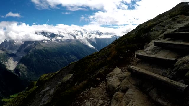 climbing wooden steps hiking in the french alps near chamonix - auvergne rhône alpes stock videos & royalty-free footage