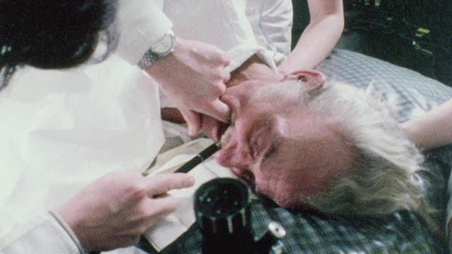 1970 shaky clinic technicians performing a gastroscopy on an elderly male patient / london, england - duodenum stock videos & royalty-free footage