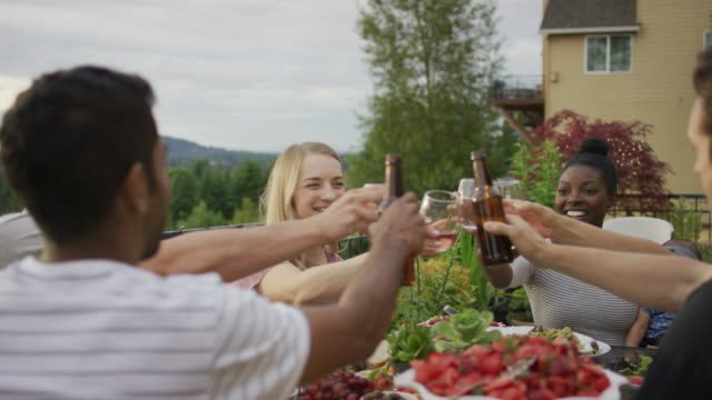 clinking drinks at an outdoor dinner - portland oregon summer stock videos & royalty-free footage
