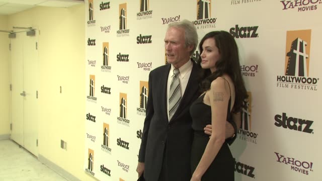 Clint Eastwood and Angelina Jolie at the 12TH ANNUAL HOLLYWOOD FILM FESTIVAL HOLLYWOOD AWARDS GALA at Los Angeles CA