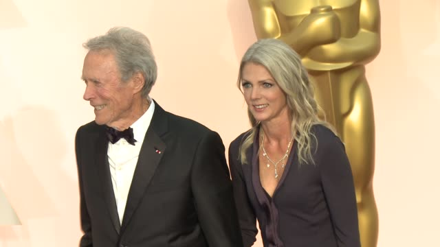 clint eastwood and christina sandera at 87th annual academy awards - arrivals at dolby theatre on february 22, 2015 in hollywood, california. - クリント・イーストウッド点の映像素材/bロール