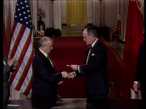 Clinton supports Yeltsin LIB MAT HELD W'TON June 1990 MS George Bush exchanges pens with Mikhail Gorbachev CMS Bush and Gorbachev shake MS Bush and...