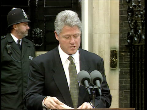 day 1; downing st lms clinton and major pose outside no.10 zoom in cms handshake cms bill clinton speaking at mics sot - cannot say enough to british... - astronomy stock videos & royalty-free footage