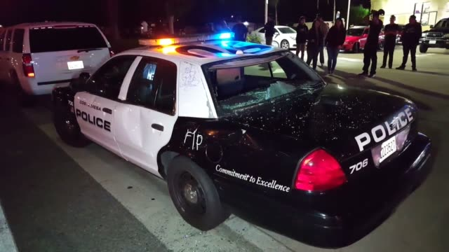 police stand guard around trump rally clip 2 protesters wreck costa mesa police car clip 3 protesters and police out side costa mesa rally - police car stock videos & royalty-free footage